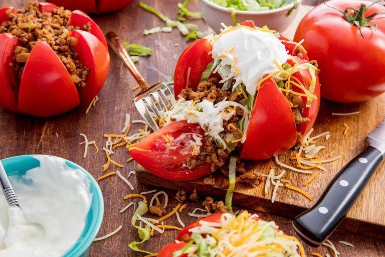 """<p>We're all for a genius low-carb hack — and these tomatoes totally deliver. </p><p>Get the <a href=""""https://www.delish.com/uk/cooking/recipes/a30053026/taco-tomatoes-recipe/"""" rel=""""nofollow noopener"""" target=""""_blank"""" data-ylk=""""slk:Taco Tomatoes"""" class=""""link rapid-noclick-resp"""">Taco Tomatoes</a> recipe. </p>"""