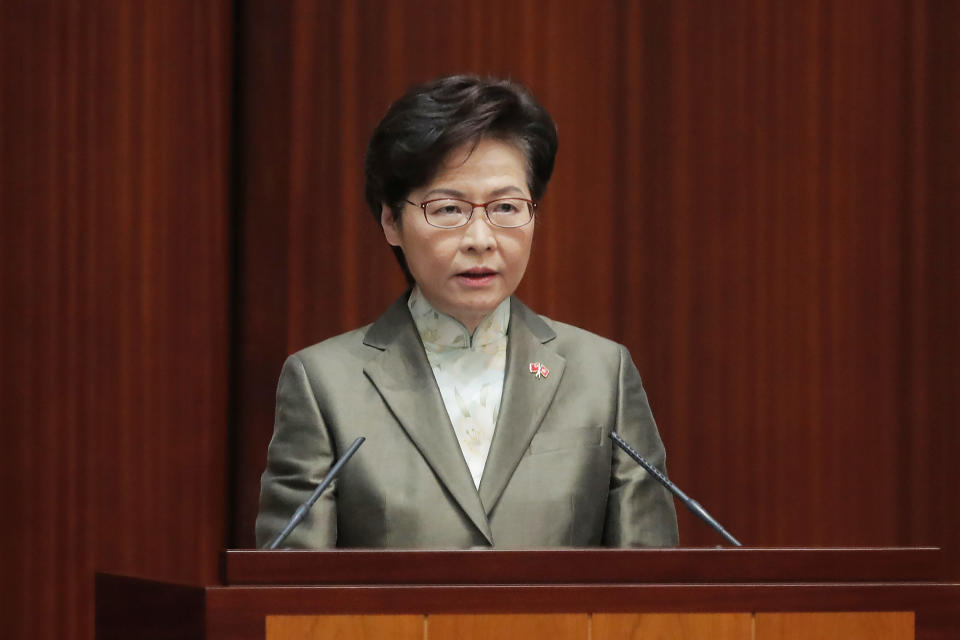"Hong Kong Chief Executive Carrie Lam delivers her policies at chamber of the Legislative Council in Hong Kong, Wednesday, Nov. 25, 2020. Lam said Wednesday that the city's new national security law has been ""remarkably effective in restoring stability"" after months of political unrest, and that bringing normalcy back to the political system is an urgent priority. (AP Photo/Kin Cheung)"