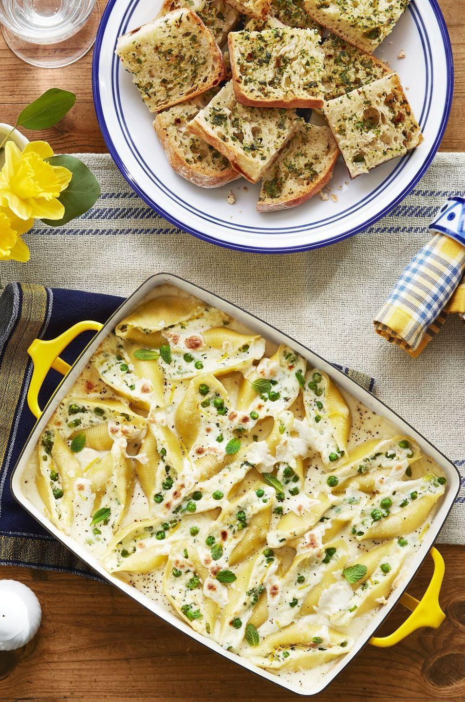 """<p>Creamy ricotta, mozzarella, and Romano cheeses are stuffed into these jumbo shells and balanced out by the hint of mint in each bite.</p><p><strong><a href=""""https://www.countryliving.com/food-drinks/a27576713/pea-and-mint-stuffed-shells-recipe/"""" rel=""""nofollow noopener"""" target=""""_blank"""" data-ylk=""""slk:Get the recipe"""" class=""""link rapid-noclick-resp"""">Get the recipe</a>.</strong></p><p><strong><a class=""""link rapid-noclick-resp"""" href=""""https://www.amazon.com/REGALO-Stoneware-Baking-14x9-5x2-5-White/dp/B07LBVT3NK/ref=sr_1_5?tag=syn-yahoo-20&ascsubtag=%5Bartid%7C10050.g.1487%5Bsrc%7Cyahoo-us"""" rel=""""nofollow noopener"""" target=""""_blank"""" data-ylk=""""slk:SHOP BAKING DISHES"""">SHOP BAKING DISHES</a><br></strong></p>"""
