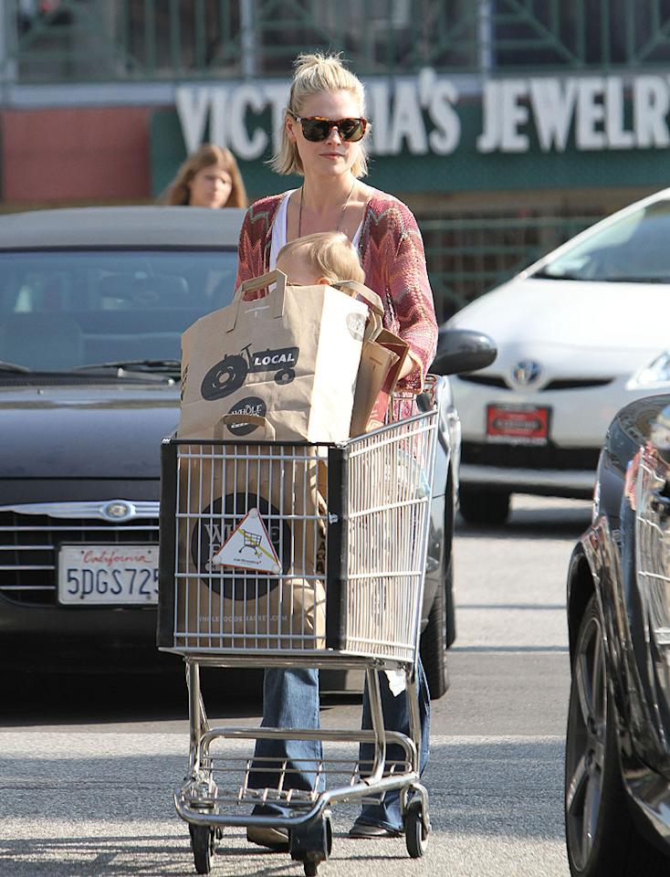 Ali Larter had her own bag boy -- her 14-month-old son Theodore -- during a grocery store outing in L.A. on Wednesday. (2/1/2012)