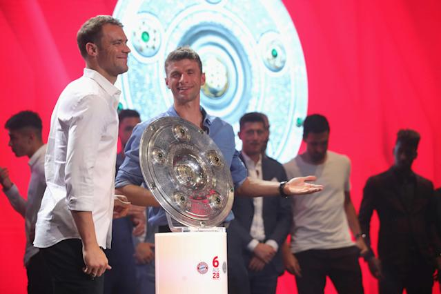 Bayern Munich's Manuel Neuer and Thomas Mueller celebrate winning the Bundesliga trophy at the Nockherberg beer garden in Munich, Germany, May 12, 2018. Picture taken May 12, 2018. Alexander Hassenstein/Pool via Reuters