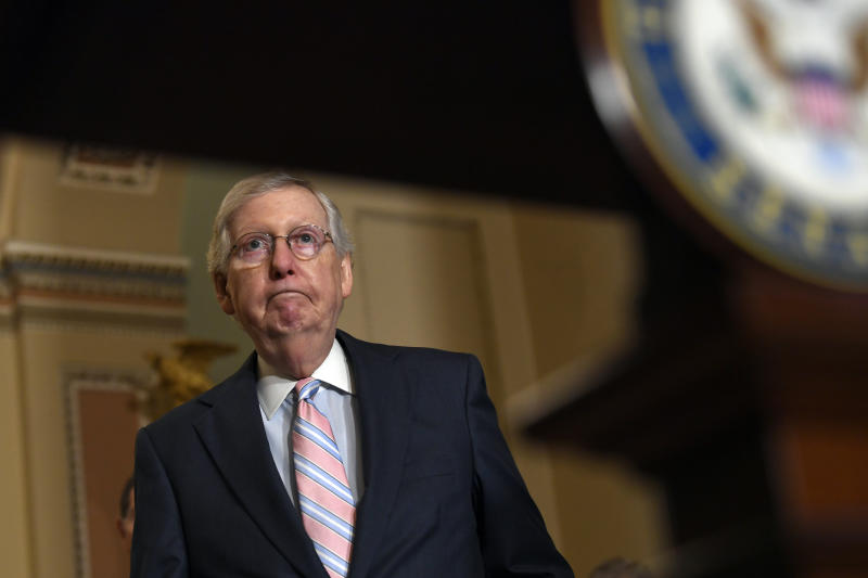 Senate Majority Leader Mitch McConnell of Ky., arrives to speak with reporters following the weekly policy lunches on Capitol Hill in Washington, Tuesday, July 23, 2019. (AP Photo/Susan Walsh)