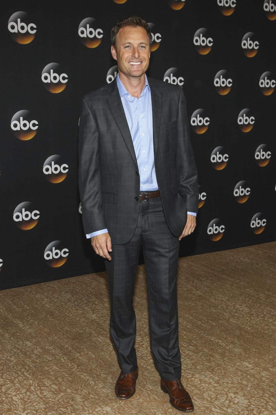 """FILE - Chris Harrison attends the Disney/ABC Television Group 2014 Summer TCA on July 15, 2014, in Beverly Hills, Calif. Harrison is stepping aside as host of """"The Bachelor"""" franchise. (Photo by Paul A. Hebert/Invision/AP, File)"""
