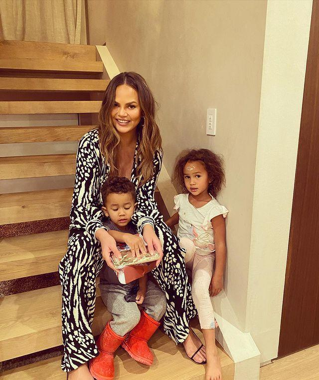 """<p>""""So so grateful for these three. Happy Thanksgiving!"""" the singer captioned a sweet shot of his wife and their kids Luna, 4, and Miles, 2 enjoying a low-key day at home on Thanksgiving. </p> <p>""""We're just going to do the staples, and it's going to be beautiful and we're going to watch football,"""" the <em>Cravings</em> author <a href=""""https://people.com/food/chrissy-teigen-downsizing-thanksgiving-meal-2020/"""" rel=""""nofollow noopener"""" target=""""_blank"""" data-ylk=""""slk:told PEOPLE"""" class=""""link rapid-noclick-resp"""">told PEOPLE</a> of their plans. Added Legend, 41: """"We're downsizing a little bit!""""</p>"""