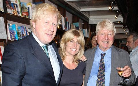 Rachel Johnson (centre) with her brother Boris and father Stanley - Credit: Getty Images