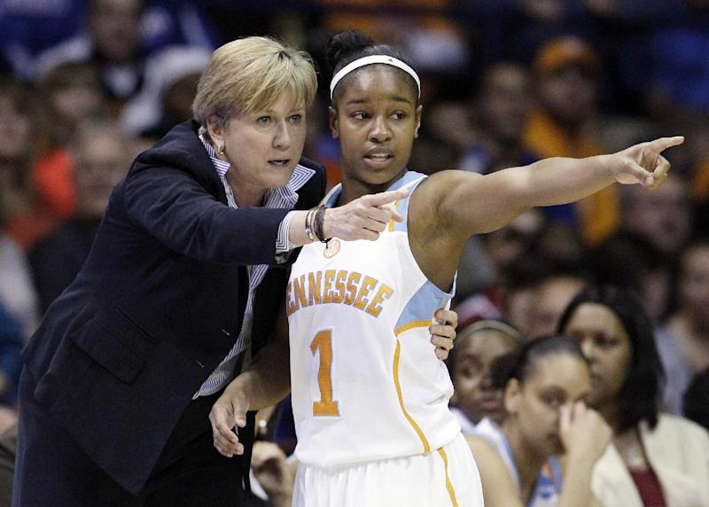 "FILE - In this March 19, 2012, file photo, Tennessee associate head coach Holly Warlick, left, talks with guard Briana Bass (1) during the first half of an NCAA tournament second-round women's college basketball game against DePaul in Rosemont, Ill. Pat Summitt, the sport's winningest coach, is stepping aside as Tennessee's women's basketball coach and taking the title of ""head coach emeritus"", the university announced, Wednesday, April 18, 2012. Long-time assistant Holly Warlick has been named as Summitt's successor. (AP Photo/Nam Y. Huh, File)"