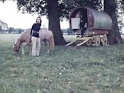 <p>Lee Radziwill poses with her horse during a photoshoot at her English estate, Turville Grange, in Buckinghamshire. The American society, who was married to Prince Stanislaw of Poland until 1974, is joined by her son, Anthony, and their pet Labrador for the photo. </p>
