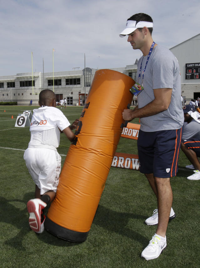Chicago Bears' Patrick O'Donnell blocks a participant during an NFL football Play 60 youth event at the Cleveland Browns practice facility Tuesday, June 24, 2014, in Berea, Ohio. The NFC rookies took part in the NFL's annual Rookie Symposium. (AP Photo/Tony Dejak)