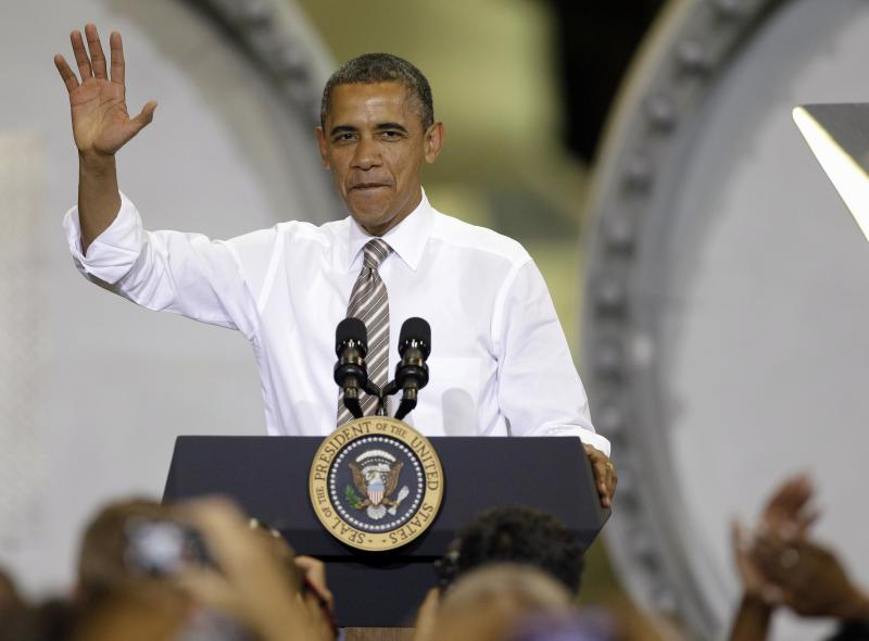 FILE - In this May 24, 2012, file photo President Barack Obama waves before speaking at TPI Composites Factory, a wind turbine blades manufacturer in Newton, Iowa. Obama argued for Congress to renew wind energy tax credits. For President Obama, losing re-election could provide a tax windfall, saving him as much as $90,000 a year if Mitt Romney's plan were enacted rather than his own tax-the-rich vision. (AP Photo/Charlie Neibergall, File)