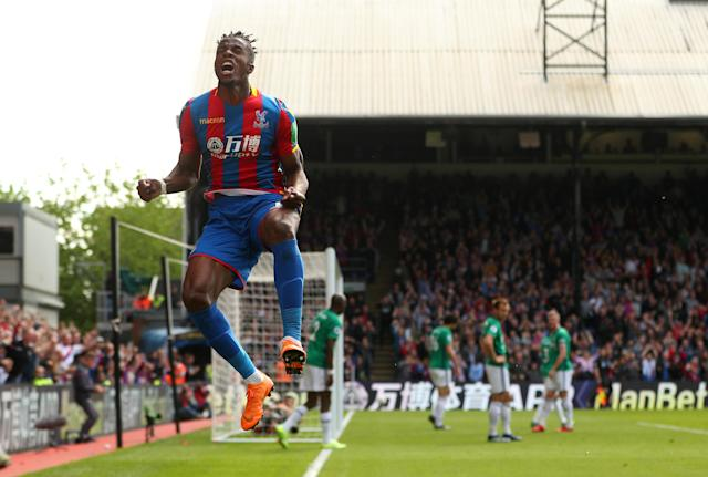 "Soccer Football - Premier League - Crystal Palace vs West Bromwich Albion - Selhurst Park, London, Britain - May 13, 2018 Crystal Palace's Wilfried Zaha celebrates scoring their first goal REUTERS/Hannah McKay EDITORIAL USE ONLY. No use with unauthorized audio, video, data, fixture lists, club/league logos or ""live"" services. Online in-match use limited to 75 images, no video emulation. No use in betting, games or single club/league/player publications. Please contact your account representative for further details. TPX IMAGES OF THE DAY"