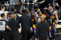 Officials separate Phoenix Suns players and Denver Nuggets players during the second half of Game 2 of an NBA basketball second-round playoff series, Wednesday, June 9, 2021, in Phoenix. (AP Photo/Matt York)