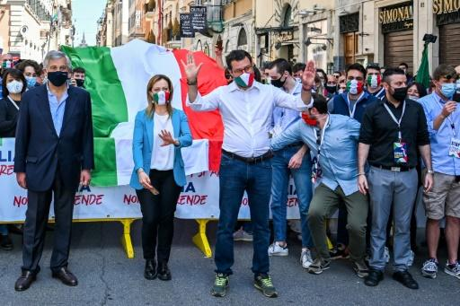 League party chief Matteo Salvini, centre, along with opposition leaders Giorgia Meloni and Antonio Tajani march in protest against the government