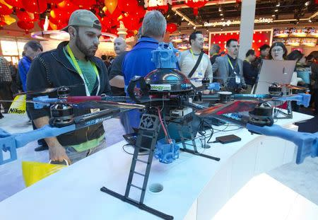 A man looks over a 360Heros drone at the Intel booth during the 2015 International Consumer Electronics Show (CES) in Las Vegas, Nevada, in this file photo taken January 6, 2015. REUTERS/Steve Marcus/Files