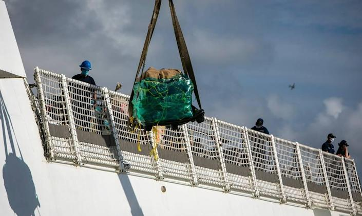 A pallet of seized drugs is taken from the deck of the U.S. Coast Guard Cutter James to Port Everglades, Fort Lauderdale on Aug. 5, 2021. The U.S. Coast Guard and Canadian military held a drug offload with about 59,700 pounds of cocaine and 1,430 pounds of marijuana from multiple Eastern Pacific and Caribbean Sea interdictions.