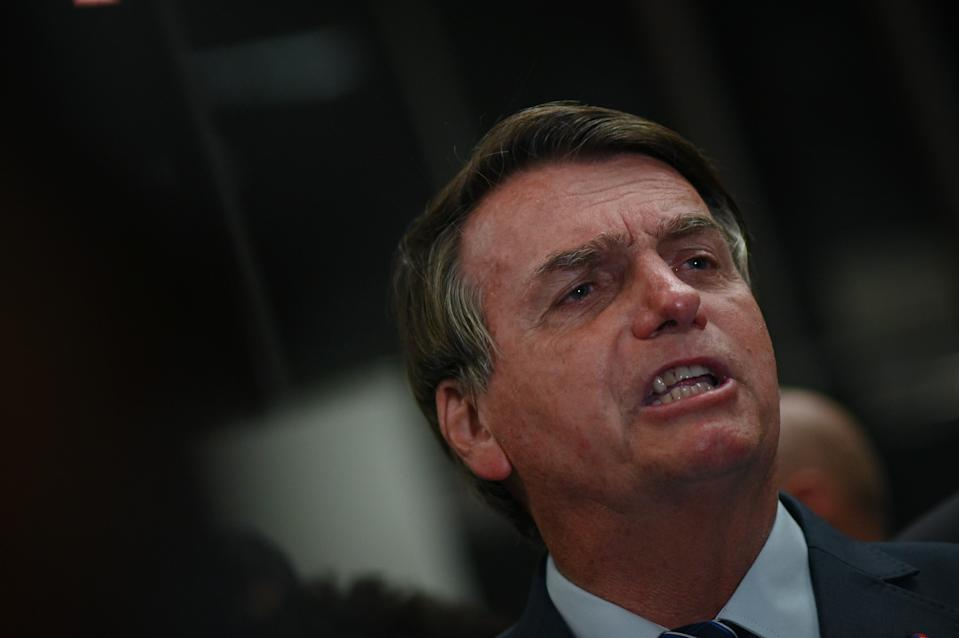 Brazil's President Jair Bolsonaro speaks to journalists without a protective face mask during a press conference amidst the Coronavirus (COVID-19) pandemic at Galeao Airport in Rio de Janeiro, Brasil, on May 5, 2021. (Photo by Andre Borges/NurPhoto via Getty Images)