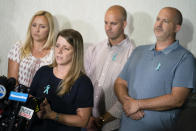 Nichole Schmidt, mother of Gabby Petito, whose death on a cross-country trip has sparked a manhunt for her boyfriend Brian Laundrie, speaks alongside, from left, Tara Petito, stepmother, Jim Schmidt, stepfather, and Joseph Petito, father, during a news conference, Tuesday, Sept. 28, 2021, in Bohemia, N.Y. (AP Photo/John Minchillo)
