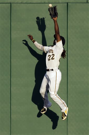 Pittsburgh Pirates center fielder Andrew McCutchen leaps to make the catch of a ball hit deep to center by Milwaukee Brewers' Ryan Braun in the first inning of a baseball game in Pittsburgh, Thursday, May 16, 2013. (AP Photo/Gene J. Puskar)