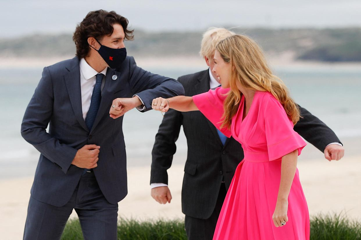 Canada's Prime Minister Justin Trudeau (L) meets Britain's Prime Minister Boris Johnson (C) and his wife Carrie Johnson (R) as he arrives for the G7 summit in Carbis Bay, Cornwall, south-west England on June 11, 2021. (Photo by PHIL NOBLE / POOL / AFP) (Photo by PHIL NOBLE/POOL/AFP via Getty Images)