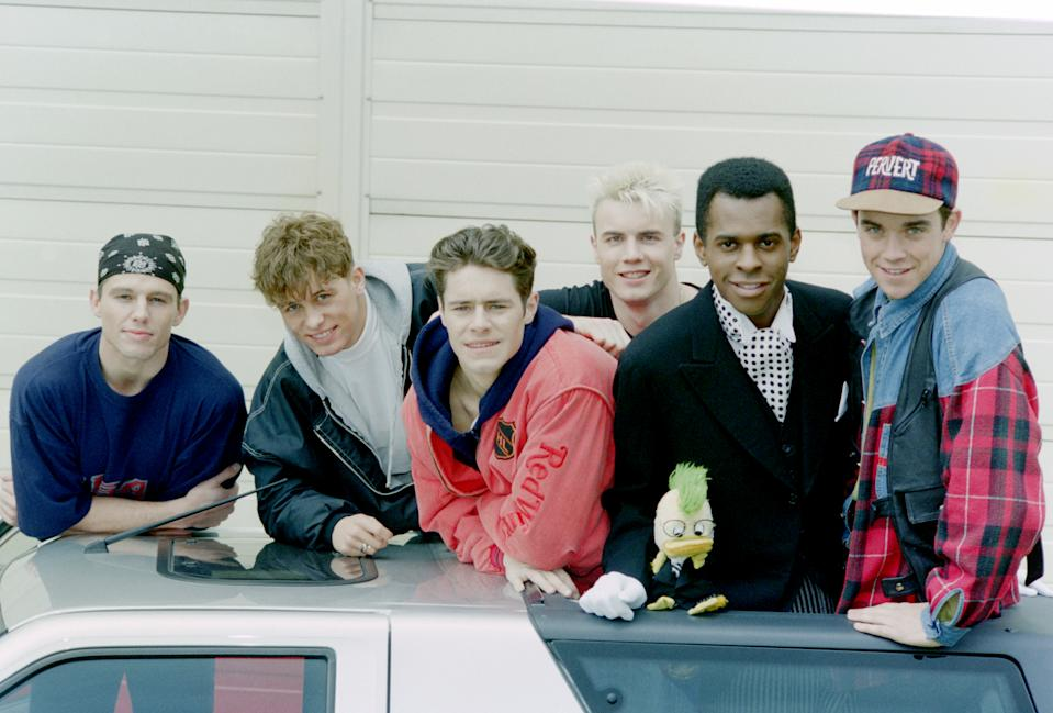 Pop band Take That pose with presenter Andi Peters during the children's TV Show 'Going Live!', circa 1990-91. (Photo by Dave Hogan/Hulton Archive/Getty Images)