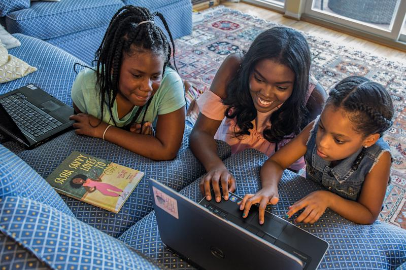 Sasha Ariel Alston (middle), a teen author, wrote a book titled <i>Sasha Savvy Loves to Code </i>to inspire girls to pursue STEM. (Annie Griffiths)