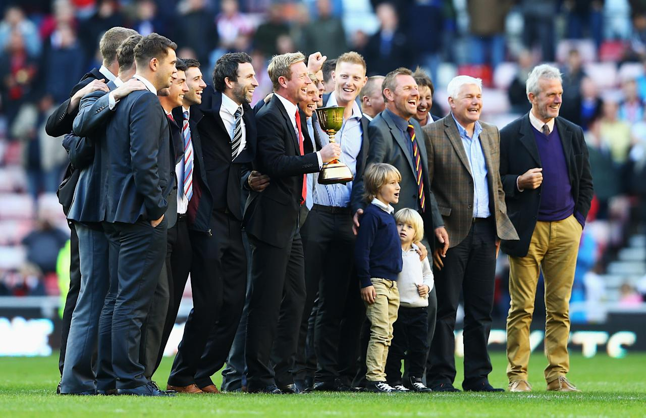 SUNDERLAND, ENGLAND - SEPTEMBER 29: Paul Collingwood of Durham celebrates with team mates at half time after winning the LV County Championship Division One title during the Barclays Premier League match between Sunderland and Liverpool at the Stadium of Light on September 29, 2013 in Sunderland, England.  (Photo by Matthew Lewis/Getty Images)