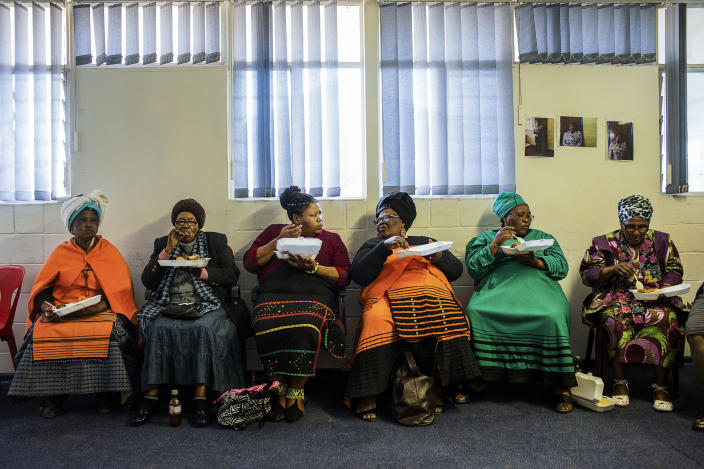 <p>Some women during a political meeting organized in the township of Khayelitsha, one of the poorest areas of Cape Town. During the meeting, free food and alcohol is offered to all present. (Photograph by Silvia Landi) </p>