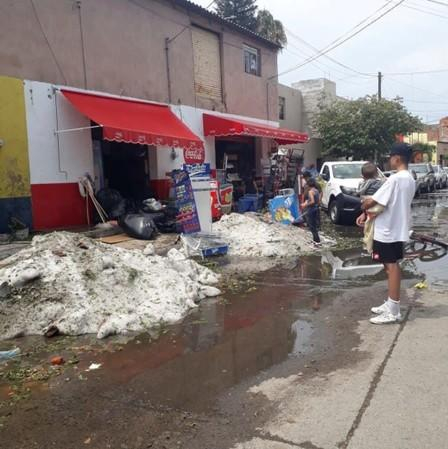 Ice is seen on a street after a heavy storm of rain and hail in Guadalajara