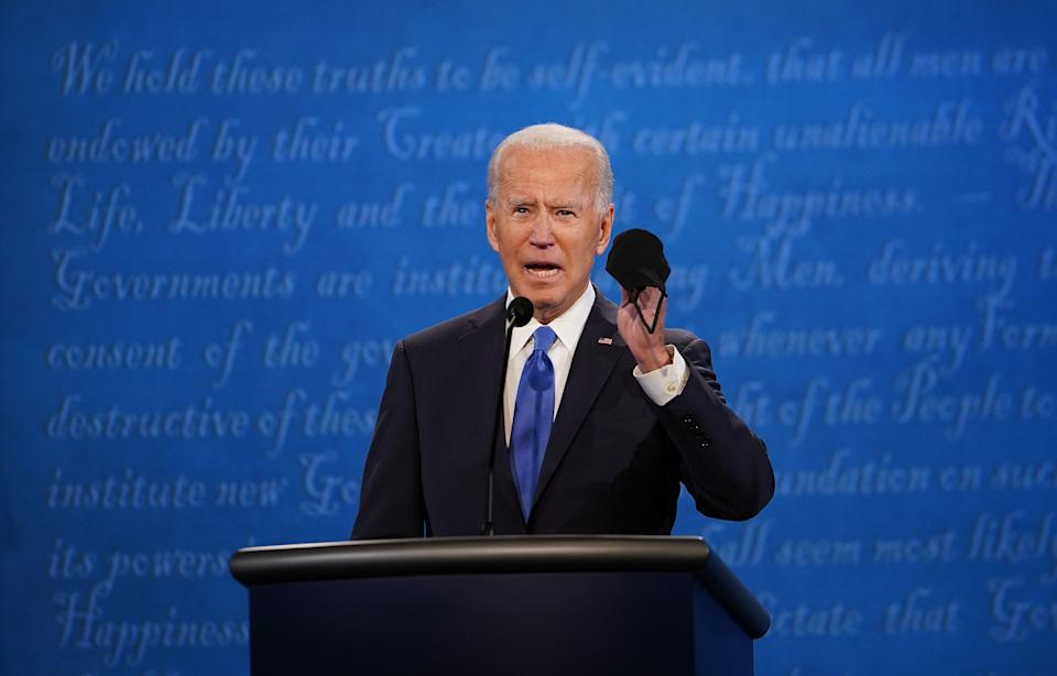"""Joe Biden holds up a mask as he speaks during the final presidential debate at Belmont University in Nashville on Oct. 22, 2020.<span class=""""copyright"""">Brendan Smialowski—AFP/Getty Images</span>"""
