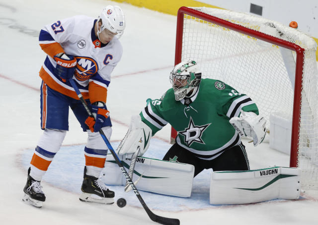 New York Islanders left wing Anders Lee (27) tries to score a goal against Dallas Stars goaltender Anton Khudobin (35) during the first period of an NHL hockey game in Dallas, Sunday, Dec. 23, 2018. (AP Photo/LM Otero)