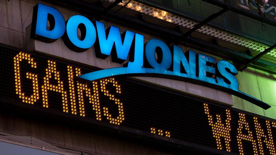 New York, USA - July 29, 2016: The illuminated Dow Jones sign in times square late in the night as the latest news streams on the led board.