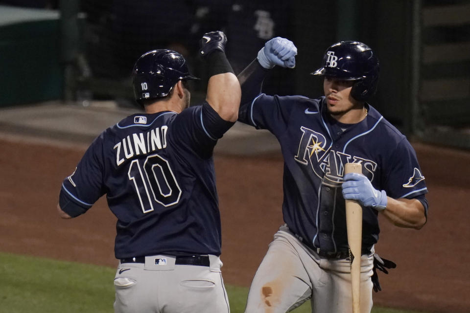 Tampa Bay Rays' Mike Zunino, left, celebrates his home run with Willy Adames during the seventh inning of the team's baseball game against the Los Angeles Angels, Thursday, May 6, 2021, in Anaheim, Calif. (AP Photo/Jae C. Hong)