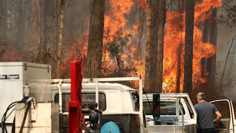 An elderly couple have died in fires that have destroyed at least 29 homes in northern NSW