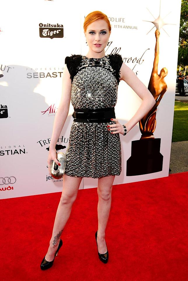 """Meanwhile, fashion fanatic Evan Rachel Wood popped a pose in a gorgeous Gucci dress and Brian Atwood pumps upon arriving at the Young Hollywood Awards. And, we even loved the dramatic color of her 'do! Jason LaVeris/<a href=""""http://www.filmmagic.com/"""" target=""""new"""">FilmMagic.com</a> - June 7, 2009"""