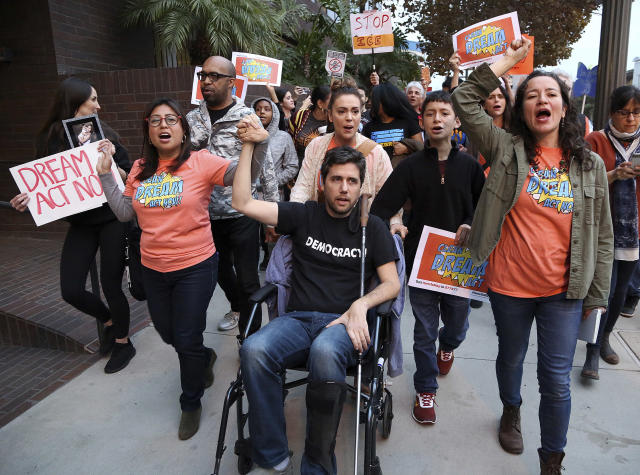 <p>Cristina Jiminez, left, and Ady Barkan, in wheelchair, lead a small delegation to the office of California Democratic Sen. Dianne Feinstein, urging the Democrats to protect the Deferred Action for Childhood Arrivals (DACA) program in Los Angeles, Jan. 3, 2018. (Photo: Reed Saxon/AP) </p>