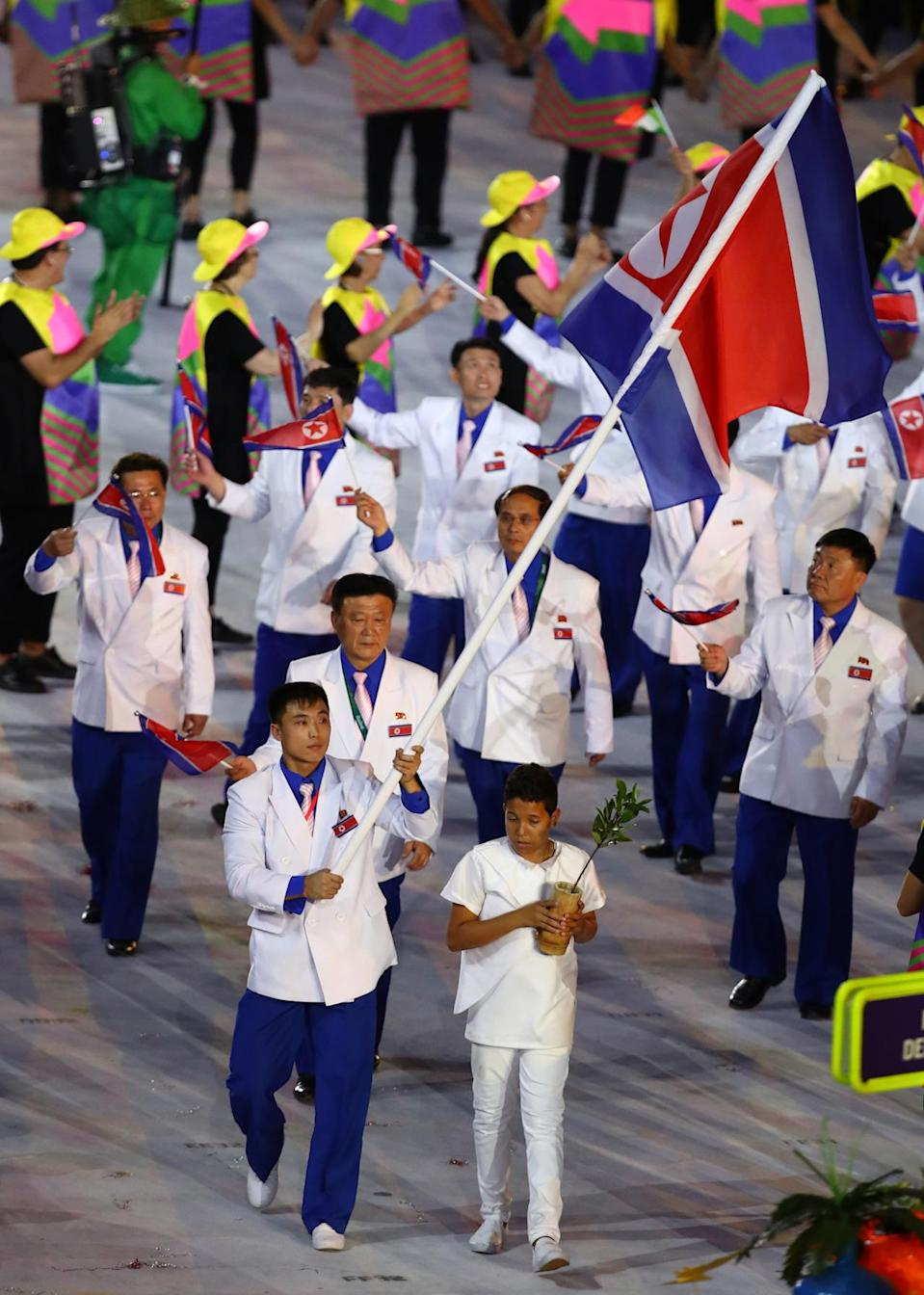 <p>The double-breasted white jackets would have looked better on lab techs. But what truly put North Korea on the worst-dressed list is that none of the athletes smiled. <br></p><p><i>(Photo: Getty Images)</i><br></p>