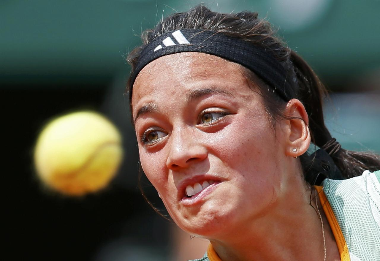 Alize Lim of France eyes the ball during her women's singles match against Serena Williams of the U.S. at the French Open tennis tournament at the Roland Garros stadium in Paris May 25, 2014. REUTERS/Jean-Paul Pelissier (FRANCE - Tags: SPORT TENNIS)