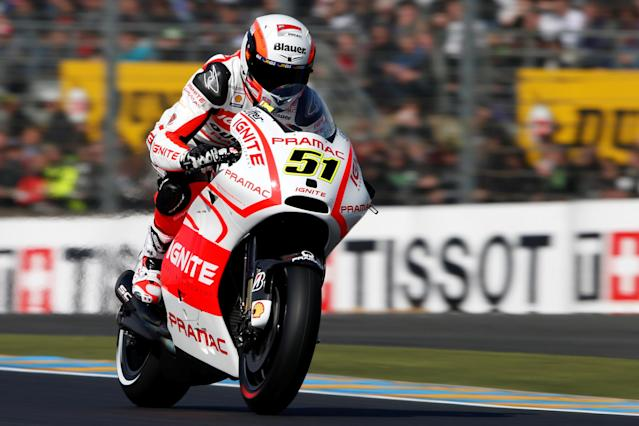 FILE PHOTO: Ignite Pramac MotoGP rider Michele Pirro of Italy takes part in the third free practice session of the French Grand Prix in Le Mans circuit, central France May 18, 2013. REUTERS/Benoit Tessier/File Photo