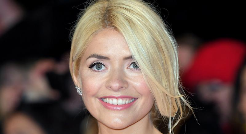 Holly Willoughby boasts a glowing complexion at the NTAs in 2019, and her make-up artist has revealed the skincare secret to her flawless skin. (Getty Images)