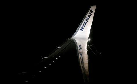 A Ryanair logo is seen on a wing of a passenger aircraft travelling from Madrid International Airport to Bergamo Airport, Italy