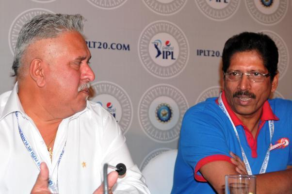 RCB team principal Vijay Mallya and member of Delhi Daredevil`s team management Thirumalai Sekhar during the two-day player auctions for the seventh edition of the Indian Premier League(IPL) in Bangalore on Feb.12, 2014. (Photo: IANS)