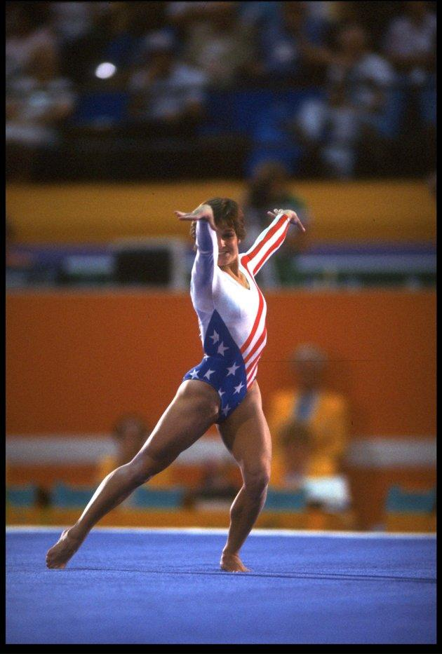 Mary Lou Retton performs her routine during the floor exercises at the 1984 Los Angeles Olympics. Retton finished in third place with a score of 19.775, but went on to win five medals, including the All Around Gold Medal in gymnastics. She's the first American woman to win this title. (Getty Images)
