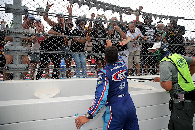 Fans cheer for Bubba Wallace, driver of the #43 Victory Junction Chevrolet, after the race at Talladega Superspeedway on June 22, 2020. (Chris Graythen/Getty Images)