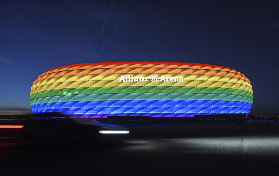FILE - In this Saturday, July 9, 2016 file photo Munich's stadium is illuminated in rainbow colors on the occasion of Christopher Street Day in Munich, Germany. UEFA has declined the Munich city council's application to have its stadium illuminated in rainbow colors for Germany's final Euro 2020 group game against Hungary June 23. Populist Prime Minister Viktor Orban has long used soccer to advance his right-wing politics, and now widespread international criticism of a new Hungarian law that is seen as targeting the LGBT community has turned this month's Euro 2020 tournament into a major stage for his challenge to Europe's liberal values. (Tobias Hase/dpa via AP, File)