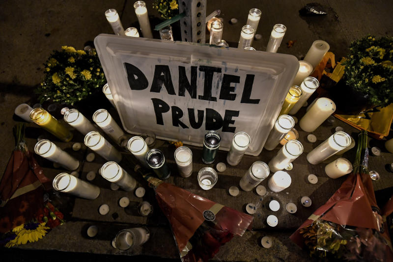 Pictured is a makeshift memorial with Daniel Prude name surrounded by many candles.