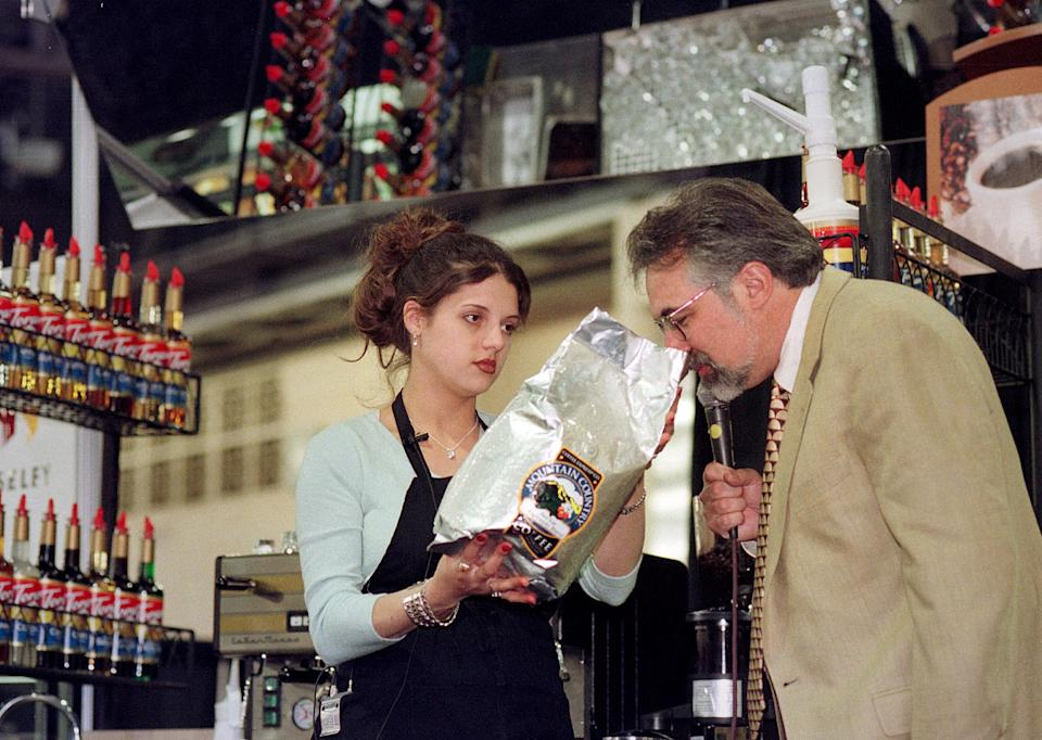 Christina Gibbs, left, from Saginaw, Mich., Holds up the brand of coffee she used to make espresso, as Paul Songer, one of the judges, sniffs the beans at the 5th Annual Barista Cup in Torani, Saturday May 1, 1999, in Philadelphia.  Gibbs was named the competition's second finalist on Monday, May 3, 1999. (Photo by William Thomas Cain)