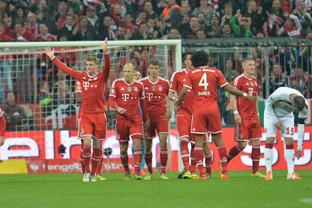 Munich's scorer Toni Kroos, left, celebrates after scoring during the German soccer cup (DFB Pokal) semifinal match between FC Bayern Munich and FC Kaiserslautern in the Allianz Arena in Munich, Germany, on Wednesday, April 16. 2014. (AP Photo/Kerstin Joensson)
