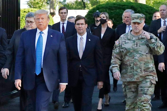 "President Donald Trump walks across Lafayette Park across from the White House to visit St. John's Church after the area had been cleared of protesters. Walking behind Trump from left are, Attorney General William Barr, Secretary of Defense Mark Esper and Gen. Mark Milley, chairman of the Joint Chiefs of Staff. Milley later said his presence was a ""mistake"" because it ""created a perception of the military involved in domestic politics."""