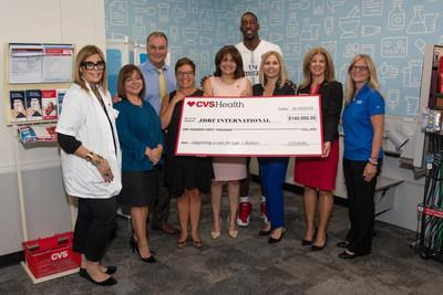 State Senator Annette Taddeo (front row center, pink dress), Miami Heat center Bam Adebayo (back row center, white shirt) and Mayra Boitel, vice president, CVS Health (front row right, red dress), along with CVS Health employees and representatives from the Juvenile Diabetes Research Foundation, attend a Project Health event on Thursday, September 19. Thursday's event was one of 48 free health screenings taking place in the Miami area between now and the end of the year.