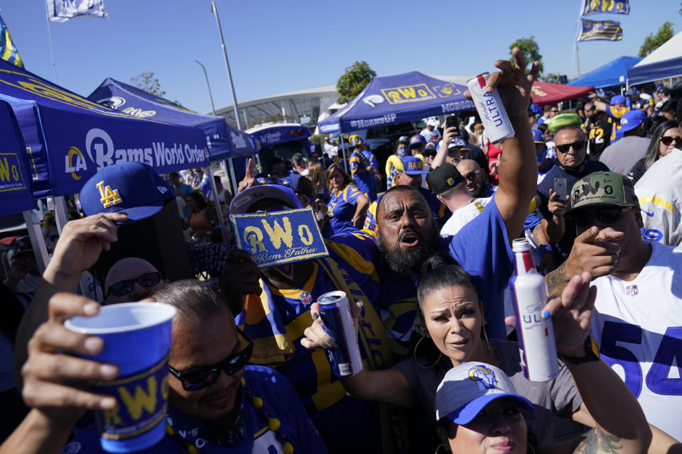 Fans for the Los Angeles Rams and the Chicago Bears tailgate before an NFL football game at SoFi Stadium Sunday, Sept. 12, 2021, in Inglewood, Calif. (AP Photo/Jae C. Hong)