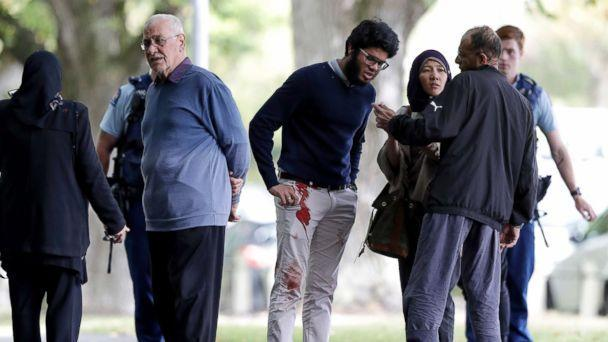 PHOTO: People stand across the road from a mosque in central Christchurch, New Zealand, March 15, 2019. (Mark Baker/AP)